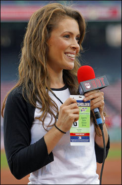 Actress Alyssa Milano is shown as she does a standup on the field during batting practice for TBS.