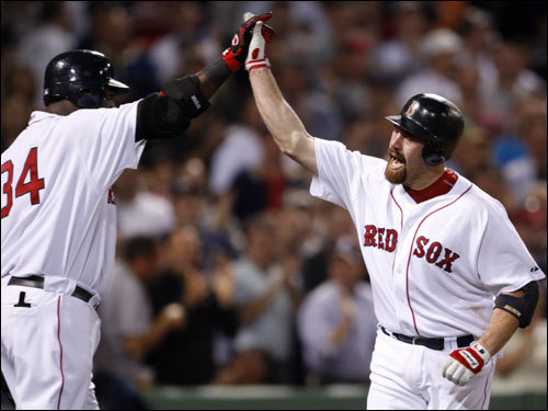 Red Sox DH David Ortiz (left) celebrated with Kevin Youkilis (right) after Youkilis's home run in the first.