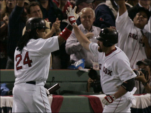 Red Sox left fielder Manny Ramirez (left) celebrated with Kevin Youkilis (right) after his first inning home run.