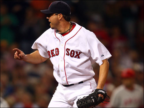 Josh Beckett reacted to striking out Garrett Anderson for the final out of the first inning.