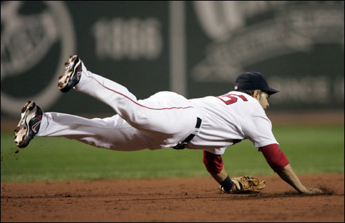 Red Sox third baseman Mike Lowell made a diving stop in the third inning.