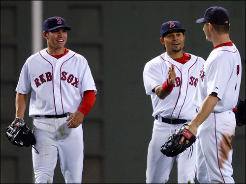 Sox outfielders Jacoby Ellsbury (left), Coco Crisp (center), and J.D. Drew (right) celebrated the victory.