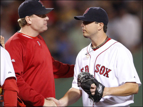 Curt Schilling (left), who will start Game 3 of the ALDS, congratulated Josh Beckett (right) after the game.