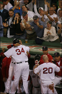 Fans cheered as David Ortiz (left) and Kevin Youkilis (right) entered the dugout.