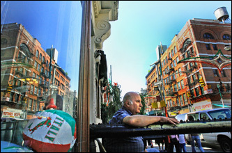 Manhattan's Little Italy may seem too touristy and far removed from the lively, 25-plus block neighborhood it once was, but don't write it off. The area is still home to wonderful Italian eateries and shops - from modern to old world. Here, Danny Vassallo sits outside his apartment on Little Italy's Grand Street.