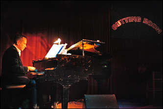Lance Cruce plays the piano before the start of a Joan Rivers performance at the Cutting Room.