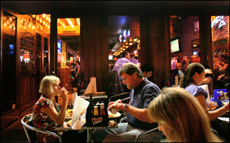 Patrons enjoy barbecue in the outdoor seating area of Southern Hospitality.