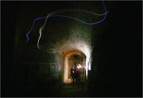 After the execution, many reported a 'lady in black' stalking the island. She is said to have scared a sentry away from his post. In the Bastion A staircase, some say they've heard her voice. The light seen in this picture baffles our photographer: 'I can't explain what the streaks of lights are in the pitch black coal room tunnel where a group of kids from Lexington Christian Academy were passing through. One of them had a flashlight, but nobody passed through the tunnel during the two-second exposure.'