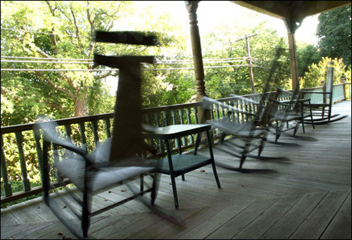 Rocking chairs on the front porch of the Beechwood Inn overlook historic Main Street. Teams who investigate the paranormal have visited the inn and documented some sort of presence, from orbs of light to shadows moving unnaturally.