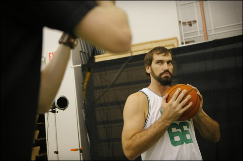Celtics' forward/center Scot Pollard strikes a pose for a photographer during media day at their training facility Friday.
