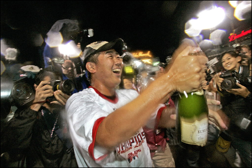 Boston Red Sox pitcher Daisuke Matsuzaka celebrates on the field after the Sox clinched the division title.