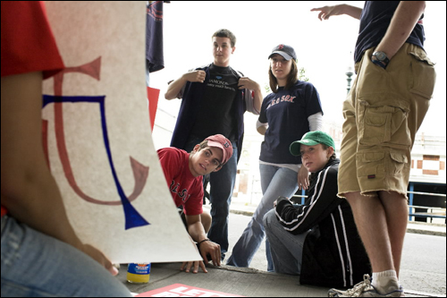 Heather Porriello (left) showed a sign she wrote displaying Red Sox shortstop Julio Lugo's name to her friends, From left: Bobby Vinson, Rob Camuso, Juliet Wilson, Liz Daley, and Mike Hickey before the first Red Sox playoff game against the Los Angeles Angels of Anaheim on Wednesday.