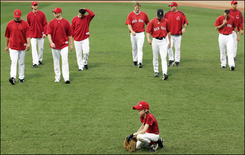 Jake Timlin (front) sat and waited while his father, Red Sox pitcher Mike Timlin, and other Red Sox players walked on the field.