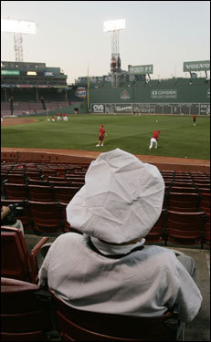 Jack Siwicke, an inside Fenway grill cook, took a minute to watch the players on the field before the start of the game.