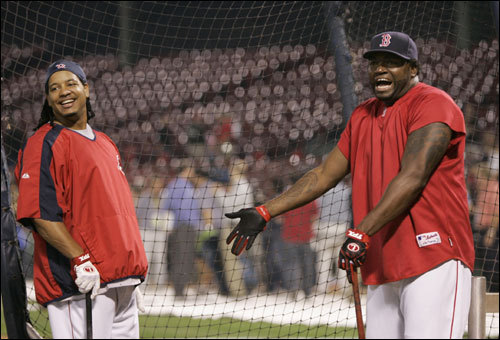 Red Sox sluggers Manny Ramirez (left) and David Ortiz (right) shared a laugh during batting practice.