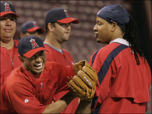 Angel shortstop Orlando Cabrera (left) talked with Manny Ramirez (right) before the game.