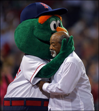 Red Sox mascot Wally the Green Monster (left) gave a hug to former Sox pitcher Luis Tiant before the game. Tiant threw out the ceremonial first pitch.