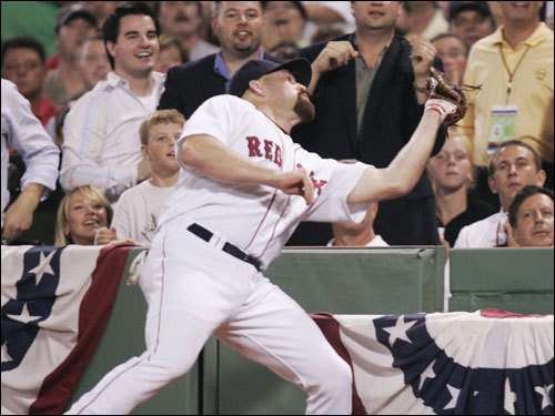 Red Sox first baseman Kevin Youkilis caught a foul ball for the second out of the inning.