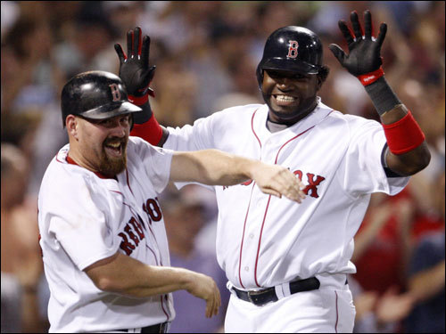 Kevin Youkilis (left) and David Ortiz (right) celebrated after scoring in the first inning.