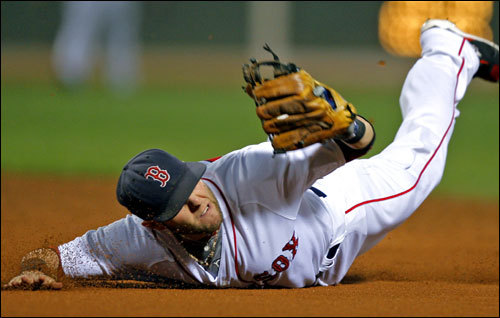 Red Sox second baseman Dustin Pedroia dove for but could not snare a second-inning single.