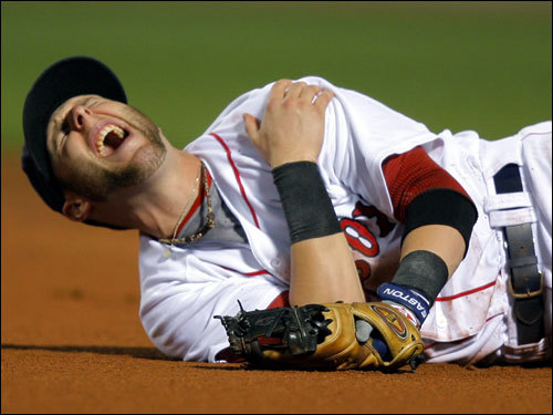 Pedroia winced in pain after the play.
