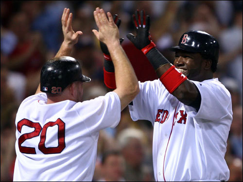 Kevin Youkilis (left) and David Ortiz (right) celebrated after scoring in the first.