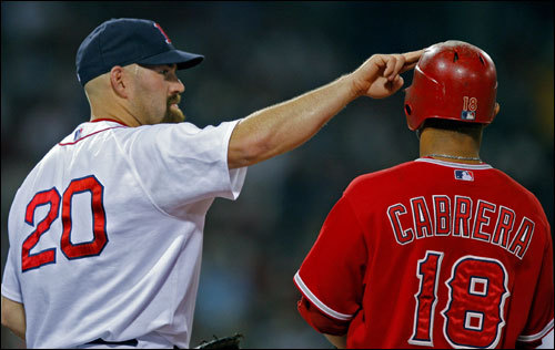 Red Sox first baseman Kevin Youkilis had some fun with Angels shortstop Orlando Cabrera as he blocked one of the vents in his helmet.