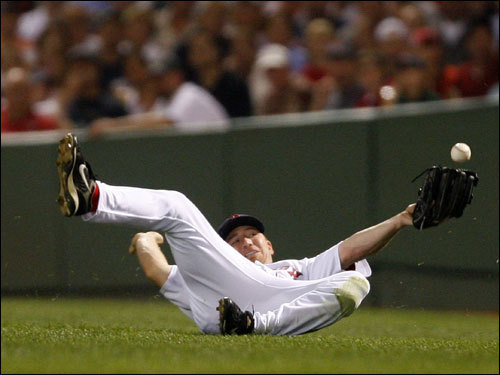 J.D. Drew slid to try and catch a ball in the third inning.