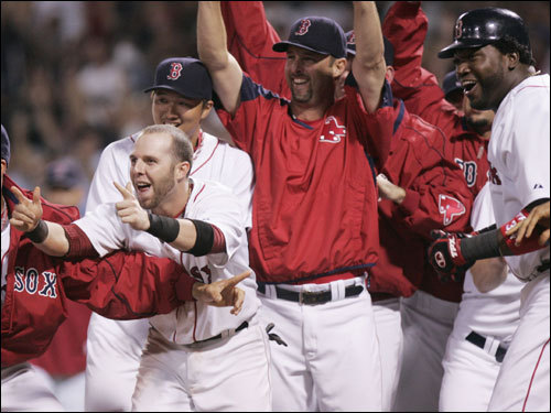 Red Sox players awaited the night's hero Manny Ramirez (not pictured) at home plate.