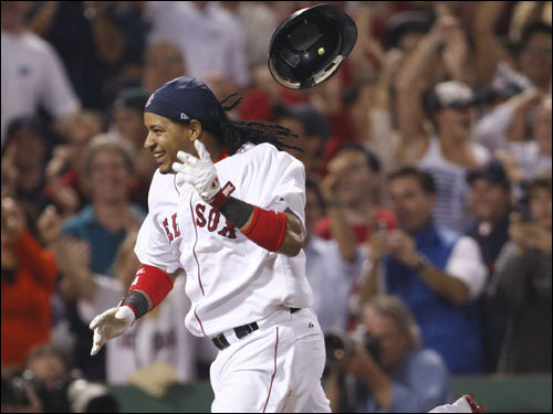 Manny Ramirez discarded his helmet before reaching home plate.