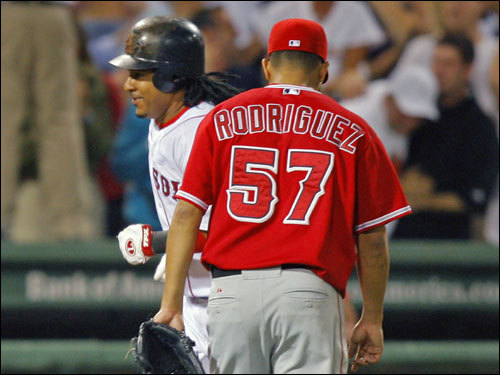 Manny Ramirez ran past Francisco Rodriguez (57), who he just hit a walkoff home run against, as he headed toward home plate.
