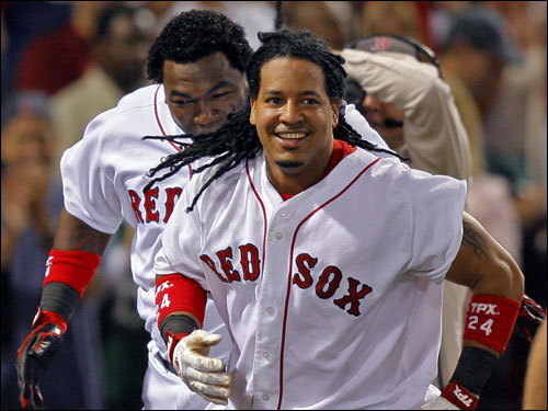 Manny Ramirez and David Ortiz celebrated on the field.
