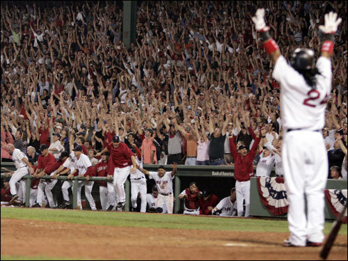 Fans at Fenway and the Red Sox dugout erupted as Manny Ramirez (right) hit a walkoff home run.