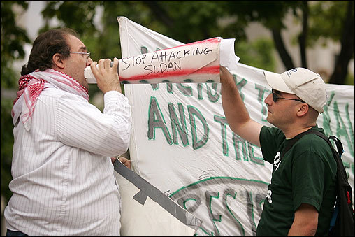 ...but also drew some controversy. At left, an MIT student (who wouldn't give his name) tried to silence a protester (who also wouldn't give his name) representing Boston Anti-Zionist Action (BAZA) during the rally. BAZA was waging an anti-imperialist demonstration and attempting to speak over the voice of genocide survivors.