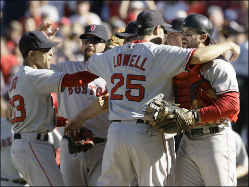 Lowell (25) celebrated with Red Sox players after completing the three game sweep of the Angels in the ALDS.
