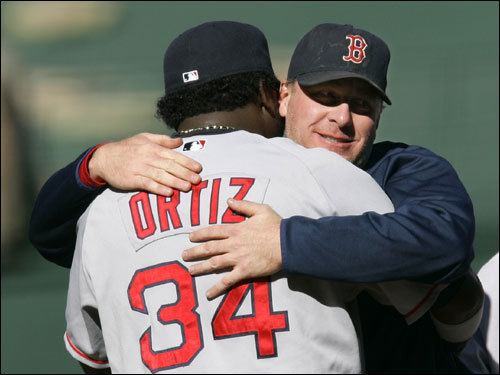 Heroes in Game 3, Ortiz (left) and Schilling hugged after the win.