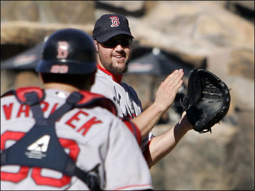 Red Sox catcher Jason Varitek (33) and pitcher Eric Gagne (right) celebrated after getting the final out.