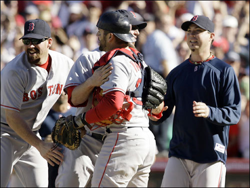 Red Sox players Youkilis (left), Gagne (center), Jason Varitek and Beckett (right) celebrated the Red Sox victory.