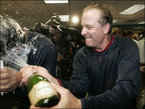Schilling sprayed champagne in the locker room after getting the win in the deciding game of the ALDS.