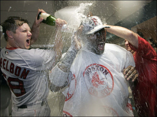 Red Sox closer Jonathan Papelbon (left) doused Ortiz with champagne.