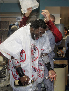 Ortiz was soaked with a bucket of liquid during the celebration.