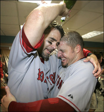 Mike Lowell (left) and Hinske celebrated in the locker room.