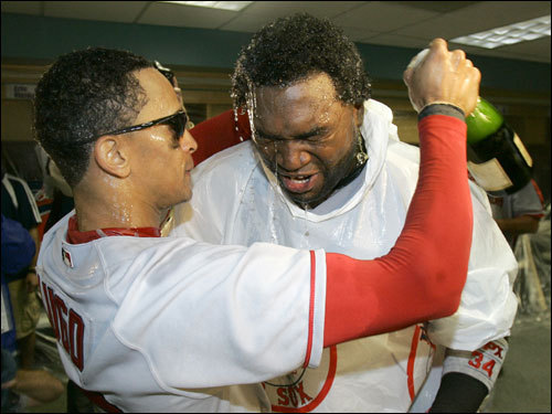 Lugo (left) and Ortiz celebrated in the locker room.