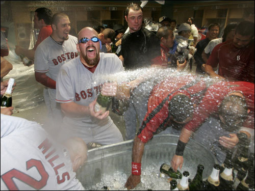 Kevin Youkilis sprayed champagne during the celebration.