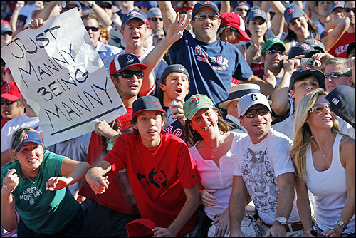 Red Sox fans were all bunched behind the dugout after the game, cheering the players.
