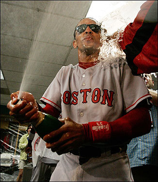Red Sox shortstop Julio Lugo was covered in water after the Red Sox won.