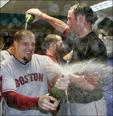 Eric Hinske (left) sprayed champagne while Jon Lester poured some on his head.