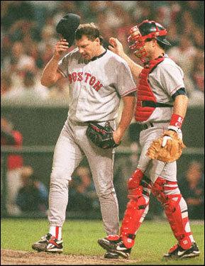 Roger Clemens (shown here with catcher Mike McFarlane) went seven innings in Game 1, giving up three runs, five hits, and a walk while striking out five. He did not factor in the decision as the Sox lost 5-4 in 13 innings when Tony Pena homered off Sox lefty Zane Smith.