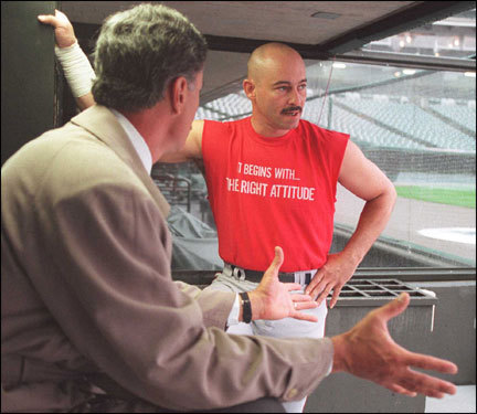 Red Sox player Dwight Evans (left) spoke with outfielder Mike Greenwell before Game 1 in Cleveland. Greenwell's T-shirt reads, 'It begins with the right attitude.' The series also ended after a three-game sweep by the Indians.