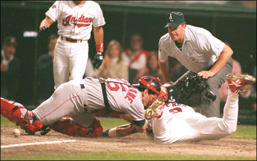 Carlos Baerga of the Indians was safe at home as the ball rolled away from Red Sox catcher Mike McFarlane during the sixth inning of Game 1. Umpire is Tim Welke.